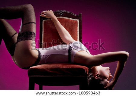 Fashion shoot of young attractive woman in vintage lingerie - stock photo
