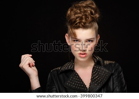 Fashion shoot of young woman in black leather jacket - stock photo