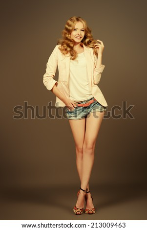 Fashion shot of a beautiful young model. Studio shot. - stock photo