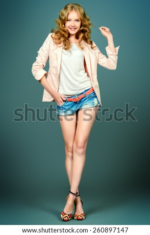Fashion shot of a beautiful young model. Studio shot. - stock photo