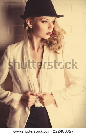Fashion shot of a glamorous blonde woman. - stock photo