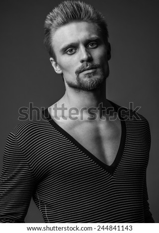 Fashion Shot of a macho Man in black and white. - stock photo