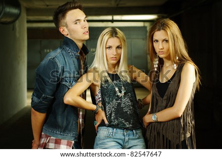 fashion shot of a trendy boy and girls - stock photo