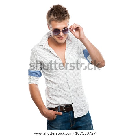 Fashion shot of an elegant young man in sunglasses, isolated on white background - stock photo