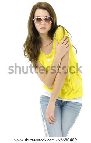 fashion shot of blond girl with sunglasses taking pose - stock photo