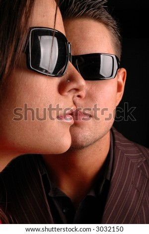 fashion shot of couple's faces - stock photo