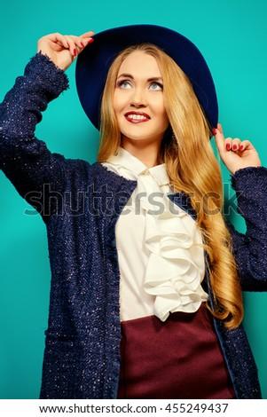 Fashion shot of the elegant young woman over bright aquamarine background.  - stock photo