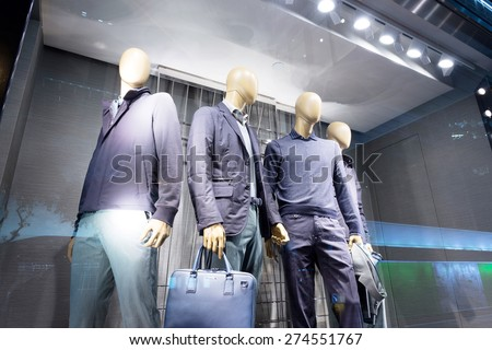 fashion store mannequins in window - stock photo