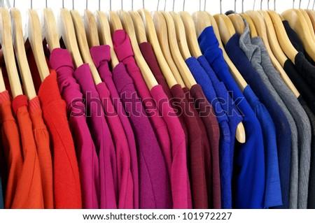 Fashion striped Shirt clothing hanging on hangers - stock photo