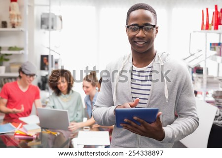 Fashion student smiling at camera at the college - stock photo