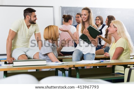 Fashion students chatting and smiling at the college - stock photo