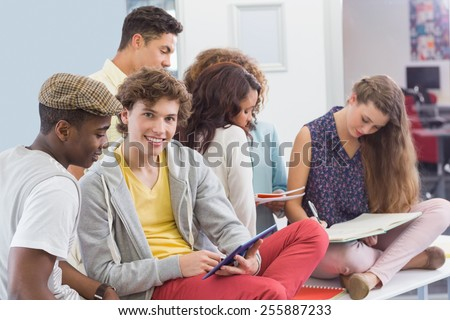 Fashion students reading their notes at the college - stock photo