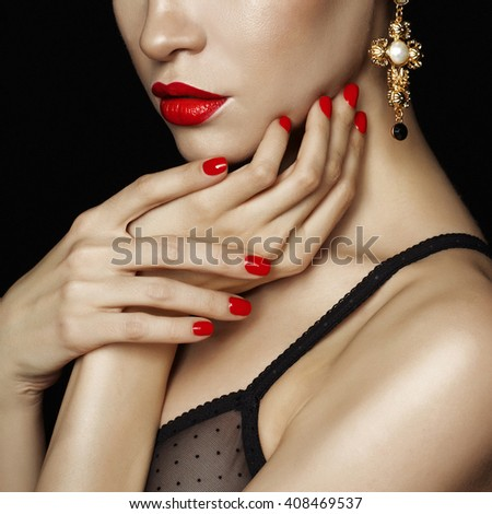 Fashion studio photo of beautiful lady with red lips and nails - stock photo