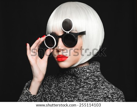 Fashion studio photo of beautiful stylish lady in sunglasses - stock photo