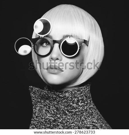 Fashion studio photo of stylish lady in sunglasses - stock photo