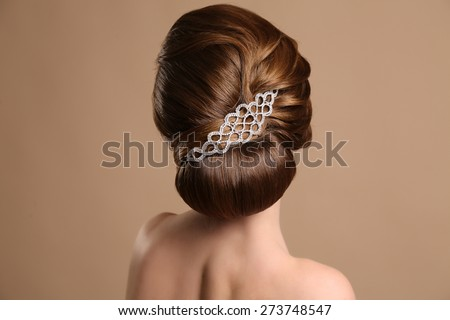 fashion studio photo of woman with elegant retro hairstyle with hair accessory - stock photo