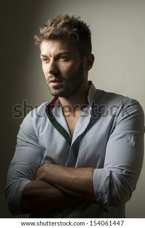 Fashion studio portrait of young handsome man  - stock photo