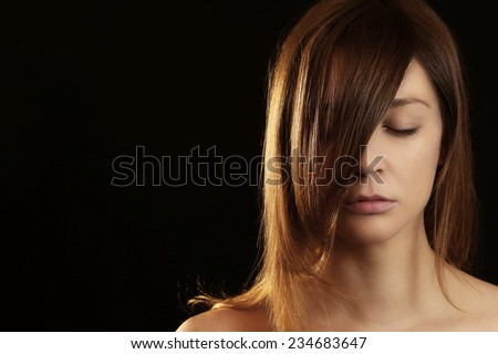 Fashion studio portrait, Portrait of beautiful caucasian woman on the black background  - stock photo