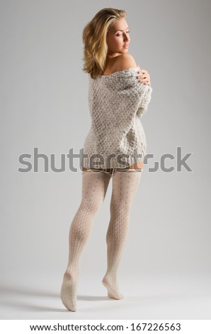 Fashion stye portrait of young girl on grey background - stock photo