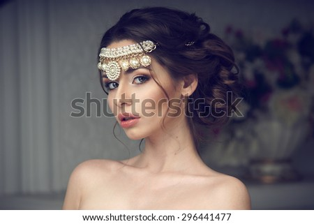 Fashion style beauty portrait of young pretty girl with perfect makeup and hairstyle looking at you or in the camera - stock photo