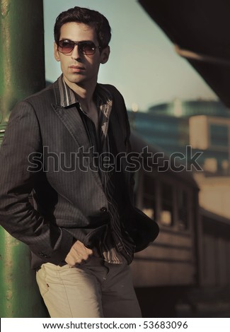 Fashion style photo of an elegant man - stock photo