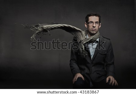 Fashion style photo of an handsome man - stock photo