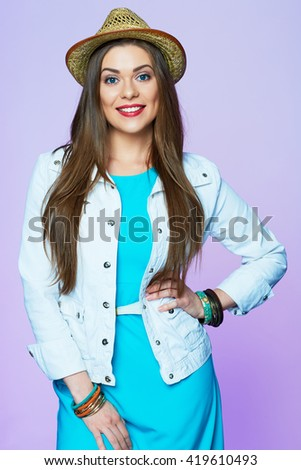Fashion style portrait of smiling woman with hat. Pink background isolated. - stock photo