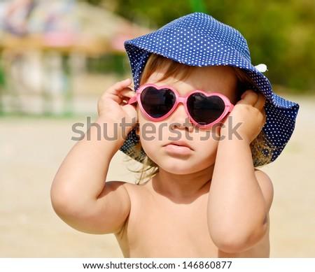 fashion toddler girl on the beach - stock photo