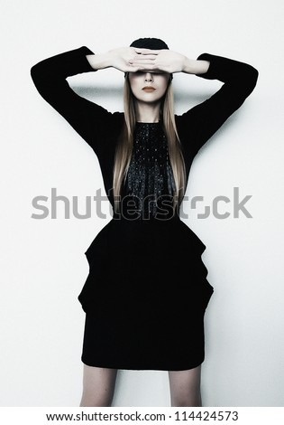 Fashion Trendy Woman Photo Model Posing in black Dress with Closed Eyes - Luxury and Elegance - stock photo