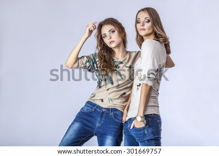 Fashion two models beautiful women Studio photography. Fashion, beauty, sexy, makeover, couple, clothes, cooking end. - stock photo