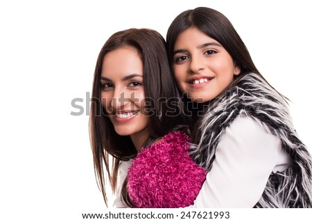 Fashion woman and girl posing over white background - stock photo