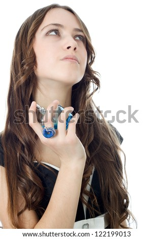 Fashion woman applying perfume on her waist over white. - stock photo