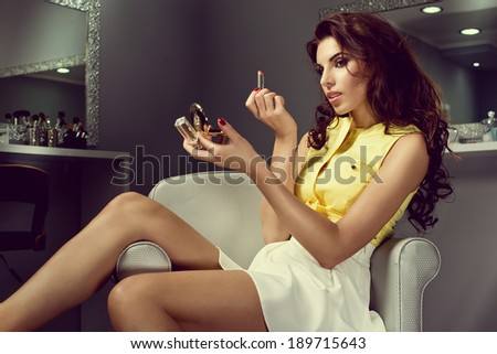 fashion woman doing make up at beauty salon  - stock photo