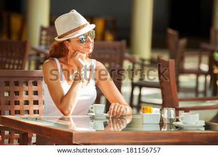 Fashion woman drinking coffee in cafe - stock photo