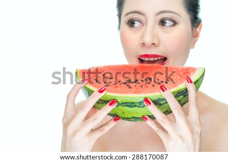 Fashion woman enjoy eating watermelon with red lips, sexy, bite, yummy - stock photo