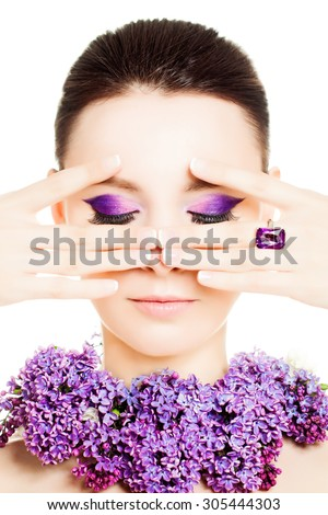 Fashion Woman. Female Face. Bright Colorful Makeup and Flowers - stock photo