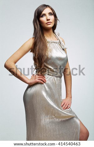 Fashion woman in evening silver dress. Female beautiful  young model. Studio isolated. Long hair. - stock photo
