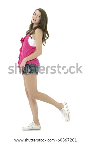 fashion woman in red-shirt and red jeans posing in the studio - stock photo