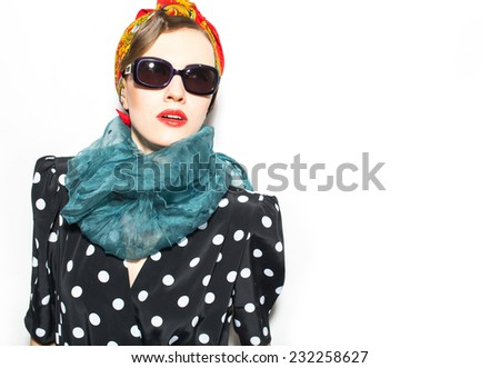 Fashion woman in scarf and sunglasses over white - stock photo