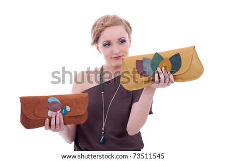 fashion woman is choosing between two nice purses, over white - stock photo