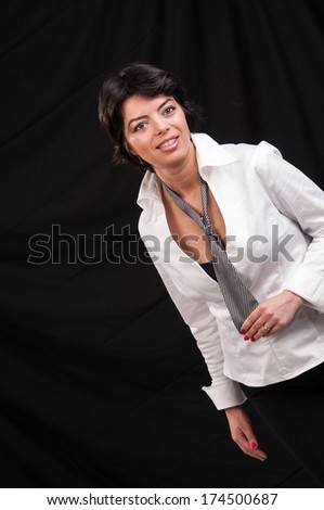fashion woman looks away while posing for the camera - stock photo