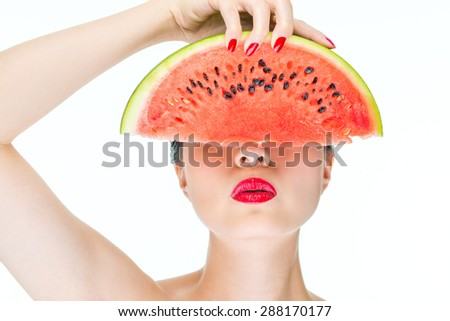 Fashion woman model holding watermelon with red lips, Nail Polish, Cross Section - stock photo