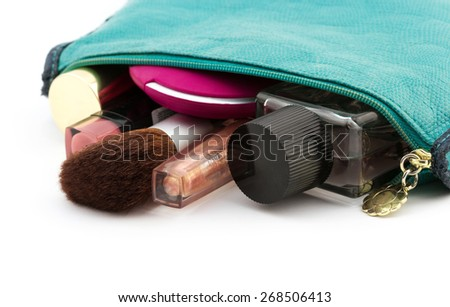 Fashion woman objects. Make up bag with cosmetics on white background - stock photo