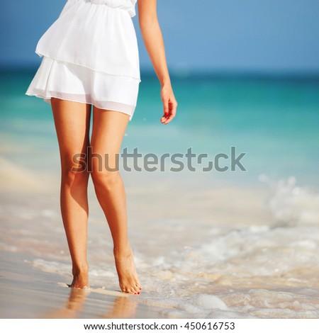 Fashion woman on the beach - stock photo