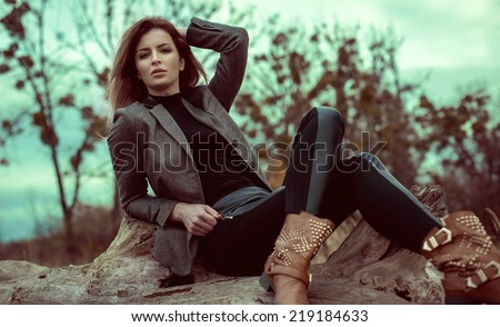 Fashion woman outdoor in autumn scenery - stock photo