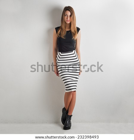 Fashion woman portrait against white wall background.  - stock photo