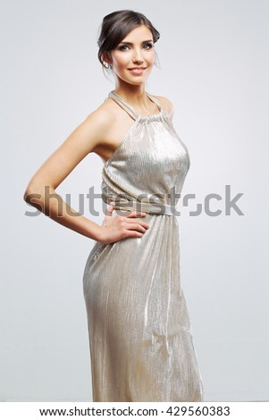Fashion woman portrait. Girl in evening silver dress.  Studio isolated , gray background . Fashion model studio poses. - stock photo