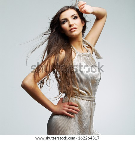 Fashion woman portrait. Hair motion. Female young model. Studio isolated , gray background . Fashion model studio poses. - stock photo