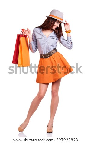 Fashion woman portrait isolated. White background. Happy girl hold shopping bag.  - stock photo