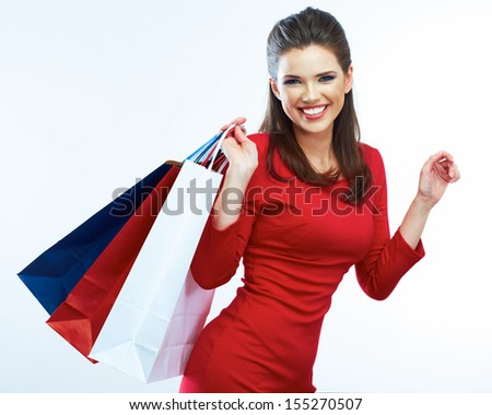 Fashion woman portrait isolated. White background. Happy girl hold shopping bag. Red dress. female beautiful model. - stock photo